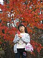 A girl holds an autumn leaf, Gunma, Japan; October 2011.jpg