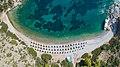 Aerial view of Nikolaos Beach Hydra, Greece (43959303125).jpg