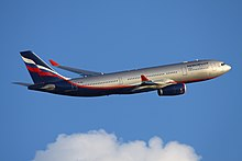 A silver, white, blue and red Aeroflot A330 after takeoff, flying across a blue sky background.