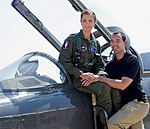 Air Force Female pilot & her husband pose for family photo on T-38 Talon aircraft she flys(171222-F-F3207-0001).jpg