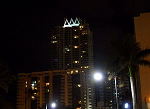 Akoya Condominiums - Akoya Condominiums at night from Collins Avenue southbound
