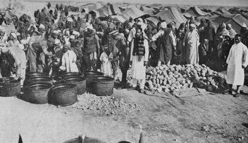 Inmates at the El Agheila concentration camp during the Pacification of Libya. The camp was recorded as having a population of 10,900 people. Al-Magroon Concentration Camp.jpg