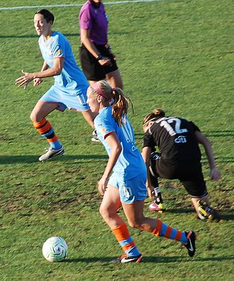 Allie Long - Long wins the ball from Christine Sinclair during a match between Sky Blue FC and Western New York Flash on July 30, 2011.
