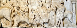 Roman sculpture - Detail from the Ahenobarbus relief showing (centre-right) two Roman foot-soldiers ca. 122 BC. Note the Montefortino-style helmets with horsehair plume, chain mail cuirasses with shoulder reinforcement, oval shields with calfskin covers, gladius and pilum