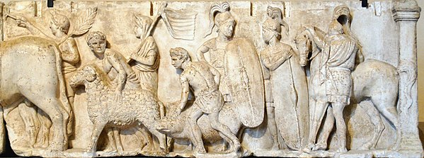 Detail from the Ahenobarbus relief showing (centre-right) two Roman foot-soldiers c. 122 BC. Note the Montefortino-style helmets with horsehair plume, chain mail cuirasses with shoulder reinforcement, oval shields with calfskin covers, gladius and pilum. Altar Domitius Ahenobarbus Louvre n3.jpg