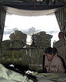 An 800lb pallet of firewood being pushed onto a C-130 Hercules of the 153rd Airlift Wing.jpg