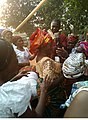 An African woman dancing at her daughter's marriage.jpg