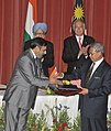 Anand Sharma and the Malaysian Minister of International Trade and Industry, Y.B. Dato' Sri Mustapa Mohamed exchanging the signed documents of the agreement towards implementing Comprehensive Economic Cooperation Agreement.jpg