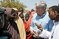 Andrew Mitchell speaks to refugees from Somalia in the Dadaab camp in northern Kenya, 16 July 2011.jpg