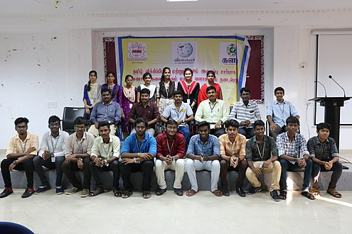 Group photo, college students standing, sitting, indoor