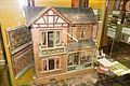 Antique dollhouse with open wing (29727267642).jpg