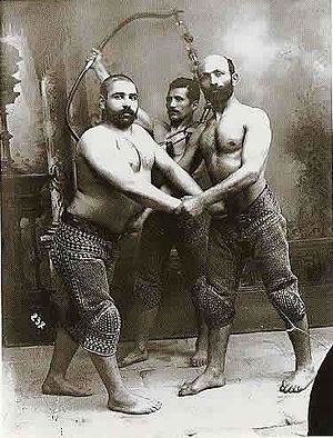 Pahlevani and zoorkhaneh rituals - Studio Portrait of Three Persian Wrestlers by Antoin Sevruguin, c.1890