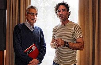 Antonio Negri - Antonio Negri  holding a copy of Commonwealth, with co-author Michael Hardt