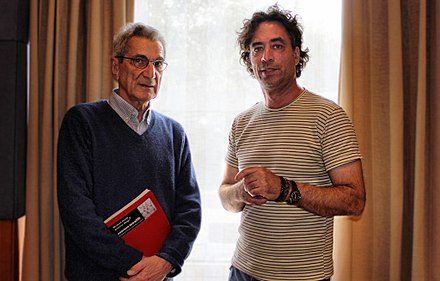 Antonio Negri holding a copy of Commonwealth, with co-author Michael Hardt Antonio Negri y Michael Hardt.jpg