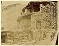 Assyrian family photographed in front of a traditional Hakkari stone house, c. 1900.jpg