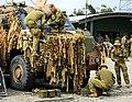 Australian soldiers attach netting to a Bushmaster PMV during Talisman Saber 2017.jpg