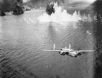 "38th Bombardment Group - B-25 engaged in ""mast head"" bombing in New Guinea."