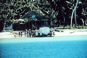 Depopulation of Chagossians from the Chagos Archipelago - The Chagossians help United States National Oceanic and Atmospheric Agency personnel bring equipment ashore in 1971. Photo by Kirby Crawford.