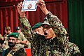 Basic trainee shows his graduation certificate during a ceremony at Afghanistan National Army Regional Military Training Center on Camp Shorabak.jpg
