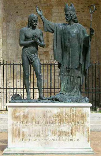 Christianization - Statue depicting the baptism of Clovis by Saint Remigius.