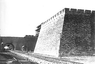 Beijing city fortifications - Beijing Inner city Chongwenmen barbican as seen in 1902. The sluice gate of the barbican has already been dismantled by invading British forces. A railway arch was built underneath.