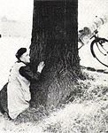 Belgian refugee takes cover, 1940.jpg