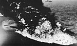 Belly tank of a Grumman F6F-5 Hellcat bursts into flames aboard USS Randolph (CV-15), in 1945.jpg
