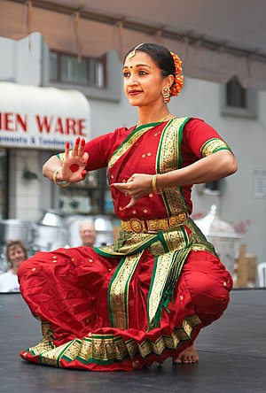 Bharatanatyam - A Bharatanatyam performer in Toronto expressing a part of a play with hand and facial gesture, in the dance's distinctive bent leg position.