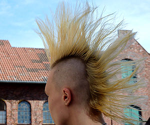 Young girl with blond mohawk in Germany.