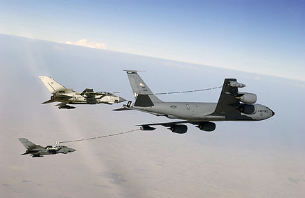 USAF KC-135 using Mk32B hose-drogue pods refueling a pair of British Tornado GR4s over Iraq in 2003. The wing pods allow for use of the centerline refueling boom. - Aerial refueling