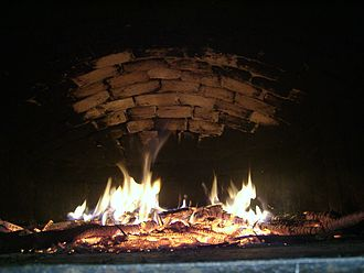 Wood-fired oven - Image: Bread oven bricks start to whiten