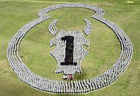 A Brigade Combat Team forming a logo on a fiel...