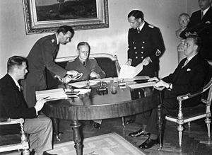 Soviet occupation of Latvia in 1940 - Signing of German–Estonian and German-Latvian nonaggression pacts.  Sitting from the left: Vilhelms Munters, Latvian MFA, Joachim von Ribbentrop, German MFA; Karl Selter, Estonian MFA.