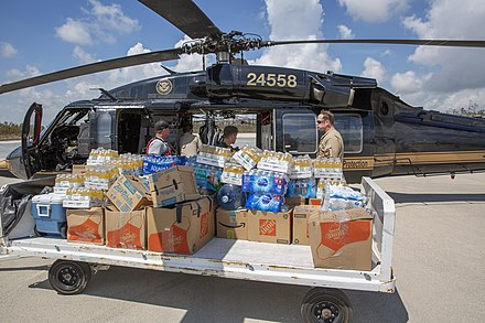 U.S. Customs and Border Protection agents deliver relief supplies to the Bahamas CBP Food and Water Delivery to Bahamas after Hurricane Dorian (48693139732).jpg