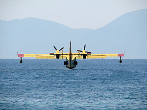Croatian Air Force and Air Defence - Canadair CL-415 filling tanks with water