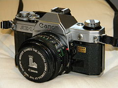 Canon AE-1 and Olympic Winter Games 1980 official sponsor cap.jpg