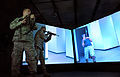 Capt. Joe Wall and Master Sgt. John MacDonald threat assessment practice via virtual firearms training simulator, April 15, 2010.jpg