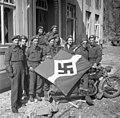 Captured German flag, Friesoythe, Germany, 16 April 1945.jpg