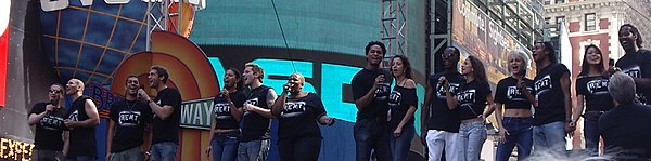 "In the 2000s, popular Broadway musicals such as Rent incorporated hip hop music influences. This picture shows the Broadway cast from 2005. Cast of Rent performing ""Seasons of Love"" at Broadway on Broadway, 2005.jpg"