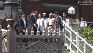 Carrie Lam (fourth from left) seen with mosque representatives leaving the premises the next day