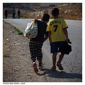 Nabi Salih -  Children picking used tear gas cartridges after the weekly demonstration in Nabi Salih, August 2014