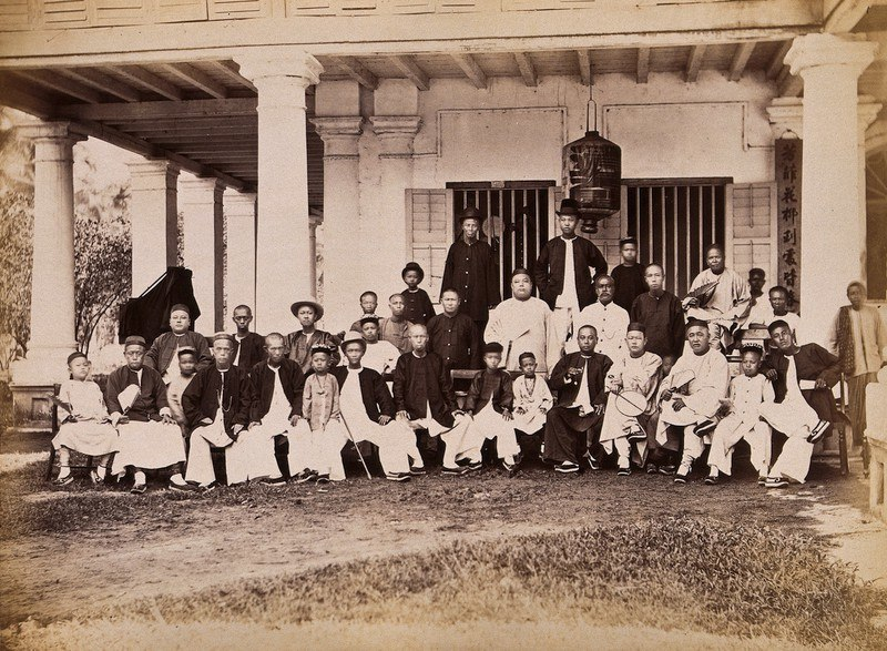 Chinese merchants grouped outside their club house on Penang Island, 1881