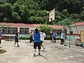 Classmates playing basketball during a class trip.jpg