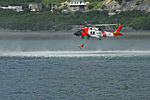 Coast Guard MH-60 Jayhawk helicopter crew deploys an aviation survival technician in Kodiak, Alaska 130725-G-FO900-036.jpg