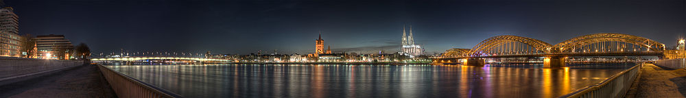 Panoramic view of the city centre at night as seen from Deutz; from left to right: Deutz Bridge, Great St. Martin Church, Cologne Cathedral, Hohenzollern Bridge