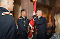 Colonel Turner passes the colors to Col. Farrell (9260639801).jpg