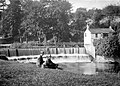 Couple seated by a weir - River Dodder (19732202922).jpg