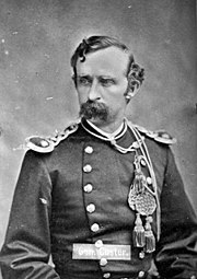 Black and White photo of Col. Custer with mustache and uniform taken in 1875.