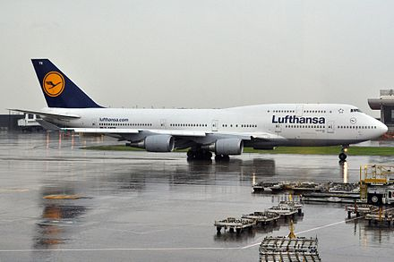 A Lufthansa Boeing 747-400 taxiing in heavy rain - Washington Dulles International Airport