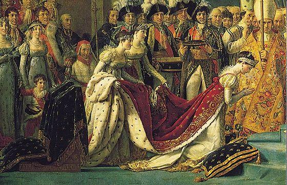 Fragmento del cuadro La coronación de Napoleón de Jacques-Louis David en el que se observa una evolución del primitivo vestido camisa hacia un traje menos sencillo y más ostentoso, aunque se mantiene el talle alto y la falda recta.[1]